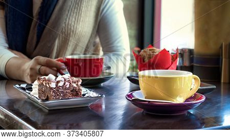 Two Ceramic Cups Of Filter Coffee Accompanied By Muffin And Rocky Road, A Traditional Desser In Tasm