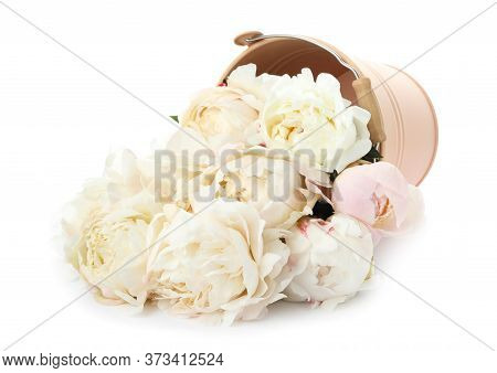 Overturned Bucket With Peonies On White Background