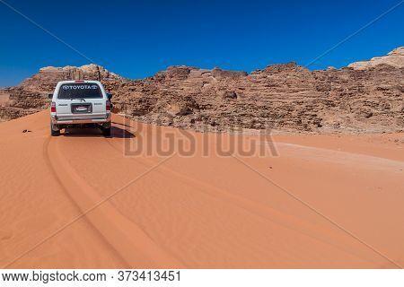 Wadi Rum, Jordan - March 26, 2017: 4wd Toyota On A Sand Dune In Wadi Rum Desert, Jordan
