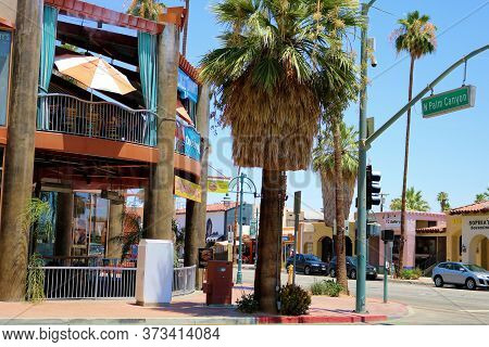 June 23, 2020 In Palm Springs, Ca:  Retail Stores And Restaurants With An Outdoor Patio And Umbrella