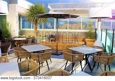 June 22, 2020 In Palm Springs, Ca:  Contemporary Style Seating And Landscaping Including Tables, Cha