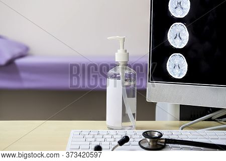 A Physician Desk With A Bottle Of Alcohol-free Hand Rub Disinfectant. One Of The Recommended Measure