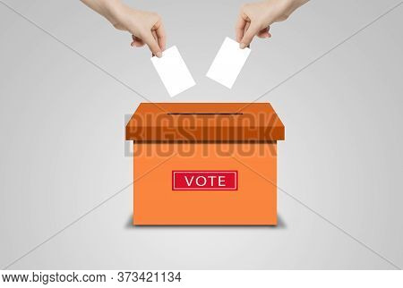 Voting Concept : Many Hands Holding White Blank Paper And Putting Voting Paper In Ballot Voting Box.