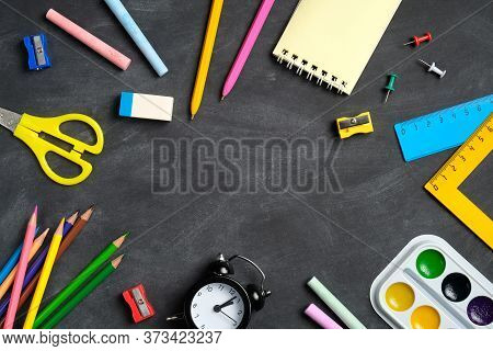 Frame Of Colorful School Supplies On Blackboard Background. Back To School Concept. Flat Lay, Top Vi