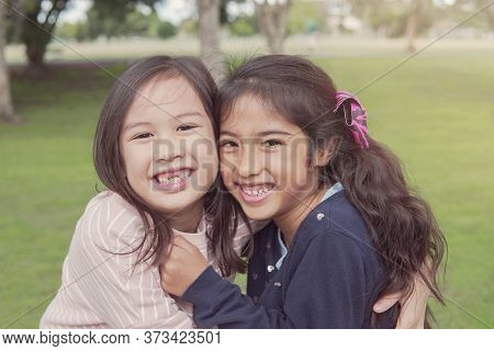 Happy And Healthy Mixed Race Young Girls Hugging And Smiling In The Park, Best Friend Kids And Child