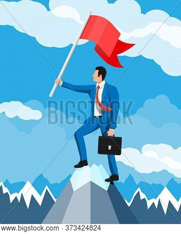 Businessman Standing On Top Of Mountain With Flag. Symbol Of Victory, Successful Mission, Goal And A