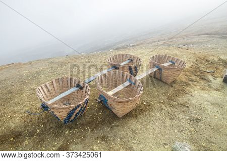 An Empty Basket Of Miners Used For Carrying Sulphur Inside The Sulphur Mine In Mount Kawah Ijen Volc