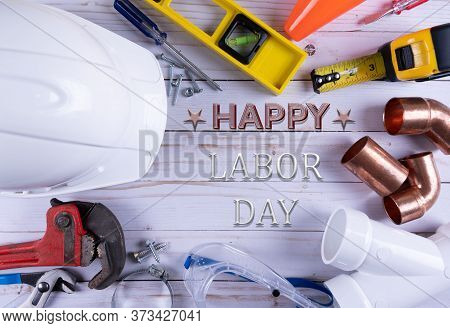 Happy Labor Day,  Construction Tools On White Wooden Background. Labor Day  Concept.  Copy Space.