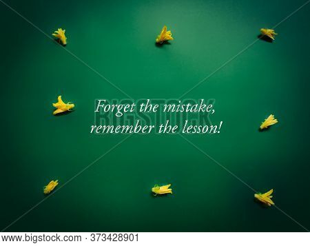 Inspirational And Motivational Quote Of Forget The Mistake Remember The Lesson In Vintage Background