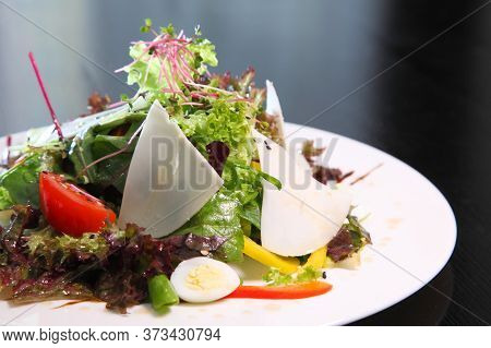 Salad With Goat Cheese. Salad With Goat Cheese, Quail Eggs And Herbs.