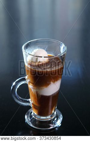 Ice Cream Coffee With A Glass Goblet With A Pen.