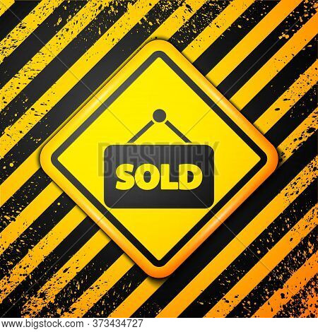 Black Hanging Sign With Text Sold Icon Isolated On Yellow Background. Sold Sticker. Sold Signboard.