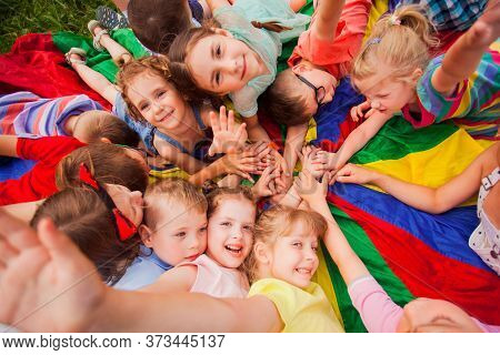 Kids At Summer Day Camp, Happily Resting On A Ground