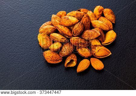 Top View Heap Of Unpeeled Fried Almonds