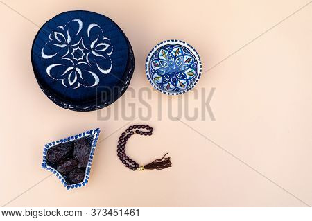 Muslim Islamic Faith Concept Taqiyah Skullcap , Red Rosary, Dates In The Bowl In The Arabic Style. N