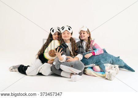 Cute Teenage Girls In Kigurumi And Sleep Masks Smiling And Shoots A Video. Selfies.