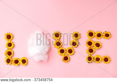 Word Love Made Of Little Yellow Sunflowers On Punk. Digital Newborn Background With Selective Focus.