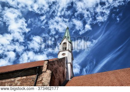 Riga, Latvia - June 11, 2016: View From Below To The Roofs Of Houses And To The Tower With A Spire I