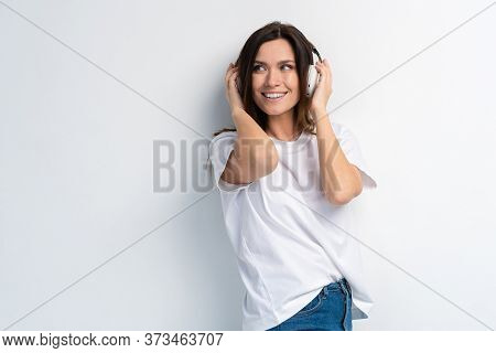 Young Happy Music Woman Isolated Portrait. Female Model Studio Isolated. Beautiful Girl