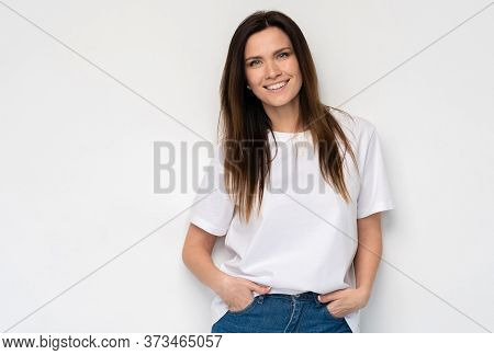 Funny Woman On White Background. Cheerful Female Model Joyful. Positive Human Emotion Facial Express