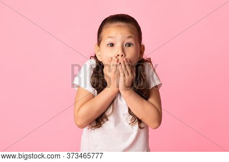 Oops. Close Up Portrait Of Amazed Asian Girl Covering Her Mouth With Hands, Isolated Over Pink Studi