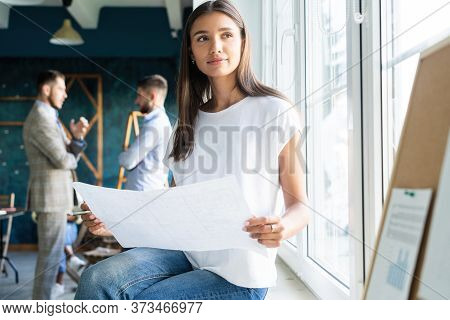 Portrait Of Young Female Architect Working On Project.