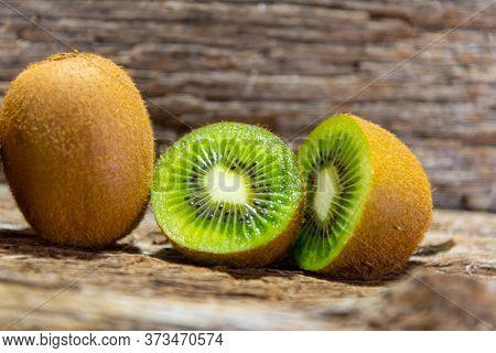 Kiwi Fruits In Natura And In Halves. Kiwi Or Kiwi (actinidia Delicious) Is A Fruit Of The Actinidiac