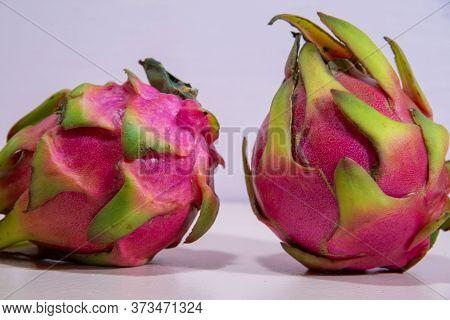 Pitaya Fruits. Pitaya Fruit. Scaly Fruit Or Dragon Fruit. Pink Background. Pytaia Isolated. Natural