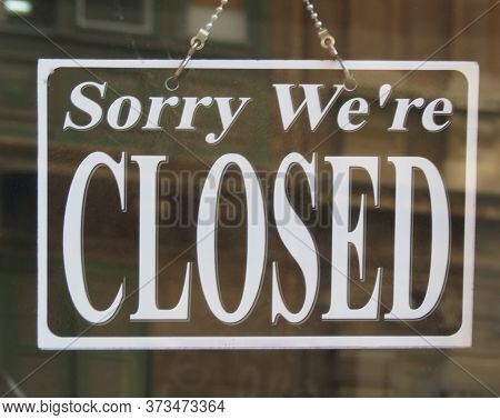 Sorry We're Closed Label Written On The Door Of A Shop