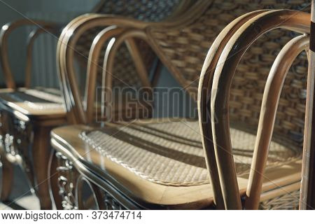 Part Of Wicker Chairs For Relaxing Close-up, Two Chairs Stand In The Shade And Sun Glare Reflects Of