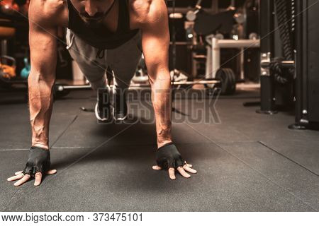 A Sporty Man In The Gym Is Doing Yoga Exercises.  Yoga Mental Benefits.