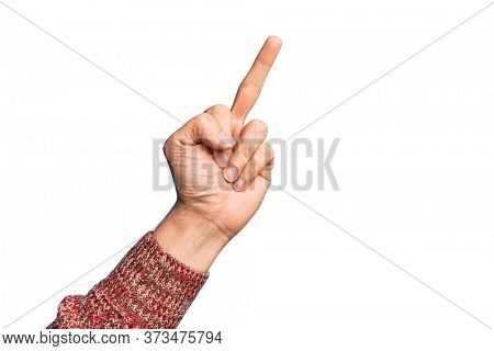 Hand of caucasian young man showing fingers over isolated white background showing provocative and rude gesture doing fuck you symbol with middle finger