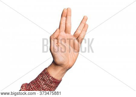 Hand of caucasian young man showing fingers over isolated white background greeting doing Vulcan salute, showing hand palm and fingers, freak culture
