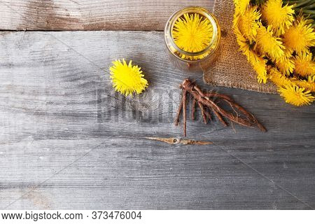 Dandelion Broth In A Glass Jar On  Vintage Wooden Background With Copy Space, Medicinal Herbs, Herba