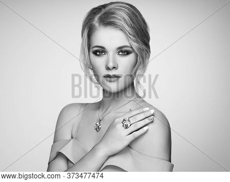 Portrait Beautiful Blonde Woman With Jewelry. Model Girl With Pearl Manicure On Nails. Elegant Hairs