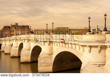 Ile De La Cite, Paris, France, Europe  - April 07, 2010: Pont Neuf Bridge Over The Seine River.