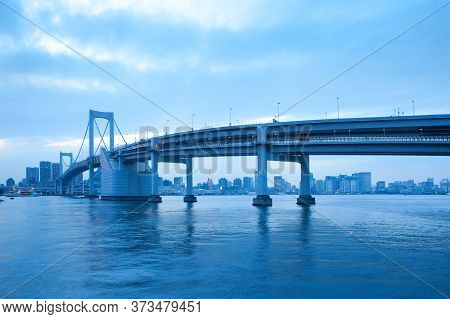 Rainbow Bridge And City Skyline At Odaiba, Tokyo, Kanto Region, Honshu, Japan