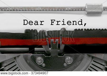 Dear Friend Text On White Sheet In Vintage Typewriter With Black And Red Ink Ribbon