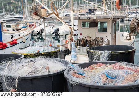 Fishing Nets Inside Huge Plastic Bins On The Waterfront After Fishing Day,quayside Of The Port Of Va