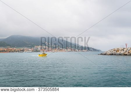 Yellow Fishing Boat While Returning To The Port Of Varazze, Liguria,italy.