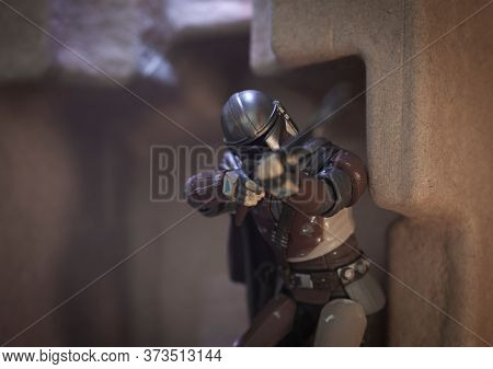 JUNE 25 2020: Recreation of a scene from Disney Plus  series Star Wars The Mandalorian - action scene with Pulse Rifle - Hasbro action figure