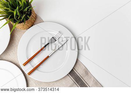 Fork, Knife And Plate On Towel. Isolated On White Background.