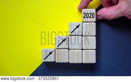Business Concept Growth 2020 Success Process. Close Up Man Hand Arranging Wood Block Stacking As Ste