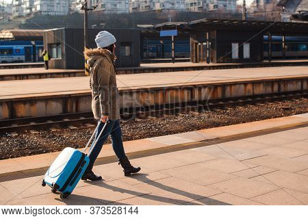 Woman Traveller With Luggage Walkway For Travel Abroad. Tourist Girl Walking At Railway Station. Tra