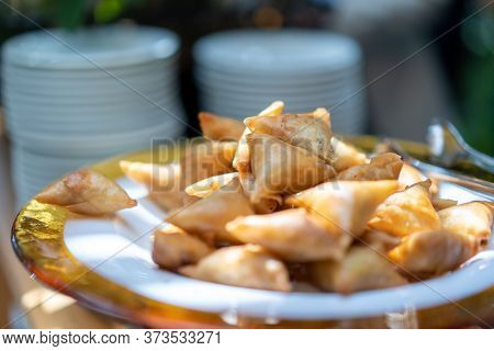 A Samosa Is A Fried Or Baked Pastry With A Savoury Filling, Such As Spiced Potatoes, Onions, Peas, M