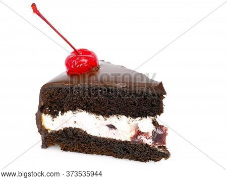 Side View Shot Of A Slice Of Chocolate Cake With Cherries And Cream Filling And Chocolate Fudge (bla