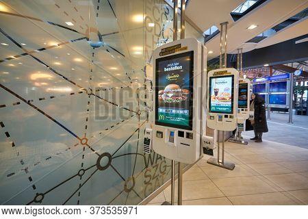 FRANKFURT AM MAIN, GERMANY - CIRCA JANUARY, 2020: McDonald's self-ordering kiosks as seen at Frankfurt am Main Airport.