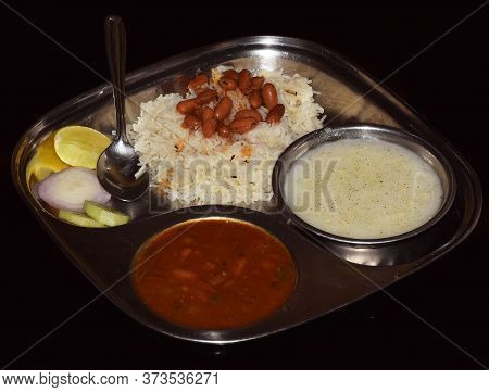 Indian Food Jeera Rice With Rajma Masala (kidney Bean Curry) And Raita  (yogurt Based) Served On A S