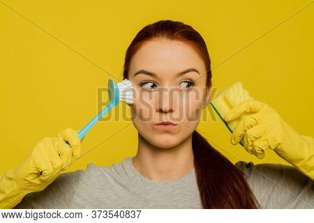 Skin Cleansing. Portrait Of Attractive Sexy Girl In Gloves Washing Face With Sponge And Brush. Close