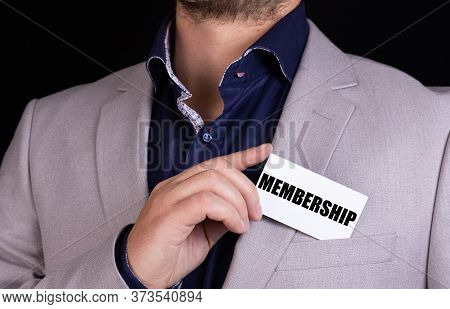 Membership Text Is Written On The Card That The Businessman Puts In His Jacket Pocket. Business Conc